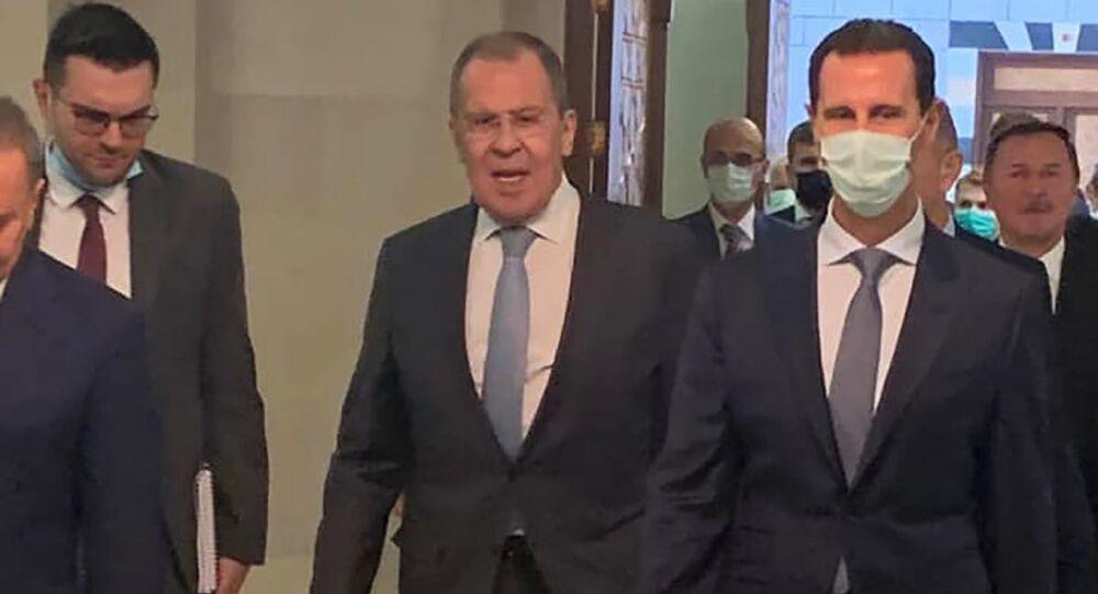 Ruský ministr zahraničí Sergej Lavrov a syrský prezident Bašár Asad
