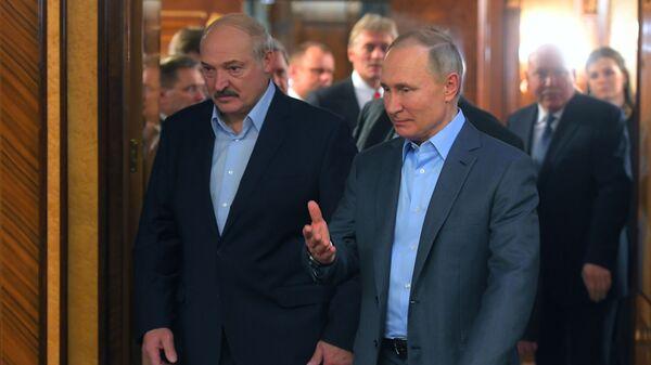 Ruský prezident Vladimir Putin a běloruský lídr Alexandr Lukašenko v Soči 7. února 2020 - Sputnik Česká republika