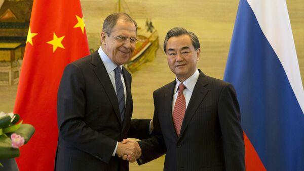 Ministři zahraničí Ruska a Číny Sergej Lavrov a Wang I - Sputnik Česká republika