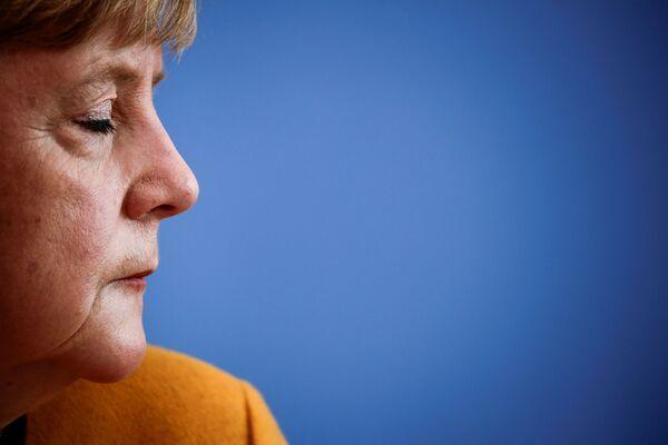 Německá kancléřka Angela Merkelová během tiskové konference ohledně koronaviru v Berlíně. - Sputnik Česká republika