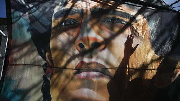 Banner s tváří Diega Maradony, Argentina. - Sputnik Česká republika
