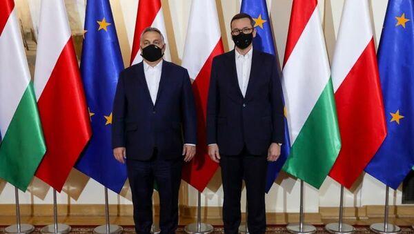 Premiér Maďarska Viktor Orbán a polský premiér Mateusz Morawiecki - Sputnik Česká republika