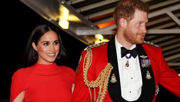 Britský princ Harry a jeho manželka Meghan Markleová - Sputnik Česká republika