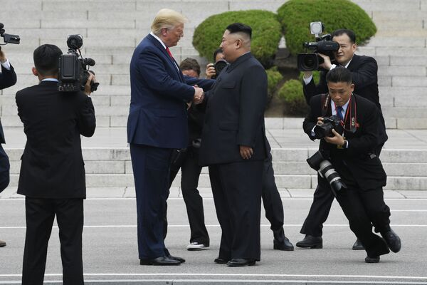 Setkání prezidenta USA Donalda Trumpa a lídra KLDR Kim Čong-una - Sputnik Česká republika