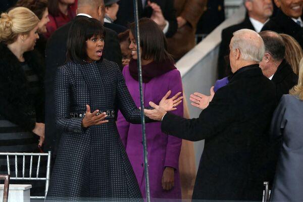 Někdejší první dáma USA Michelle Obamová a viceprezident Spojených států Joe Biden - Sputnik Česká republika