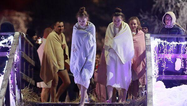 Inaugurace prezidenta USA, oslavy Křtu Páně v RF, výbuch v Madridu: Ohlédněme se za uplynulým týdnem pomocí fotografií - Sputnik Česká republika