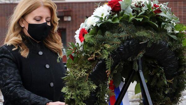 Prezidentka Slovenské republiky Zuzana Čaputova  během ceremonie uctění památky obětí holocaustu  - Sputnik Česká republika