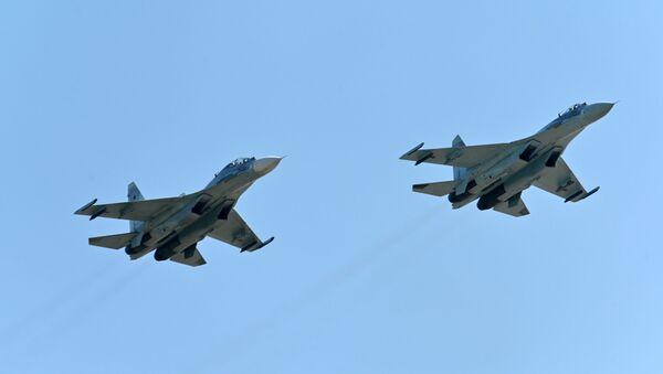 Stíhačky Su-27 (archivní foto) - Sputnik Česká republika
