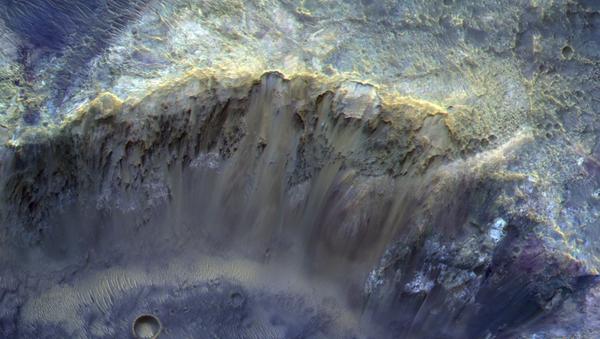 Snímek kráteru na povrchu Marsu. Ilustrační foto - Sputnik Česká republika