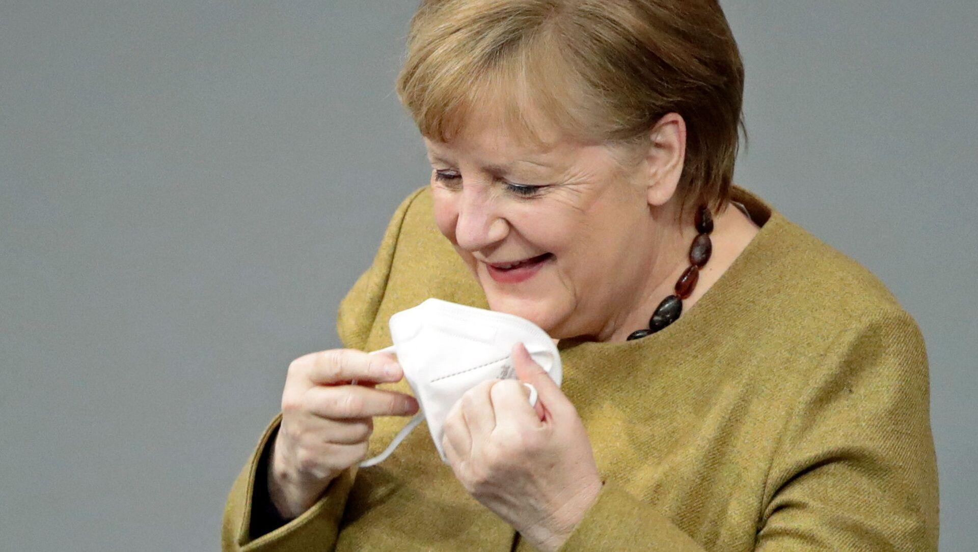 Německá kancléřka Angela Merkelová si zapomněla nasadit roušku - Sputnik Česká republika, 1920, 25.02.2021