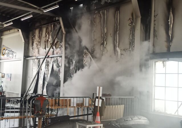 Na místě požaru na letišti Točná v Praze