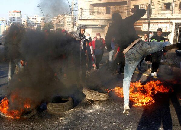 Protestní akce v Libanonu proti poklesu měnového kurzu libanonské libry. - Sputnik Česká republika