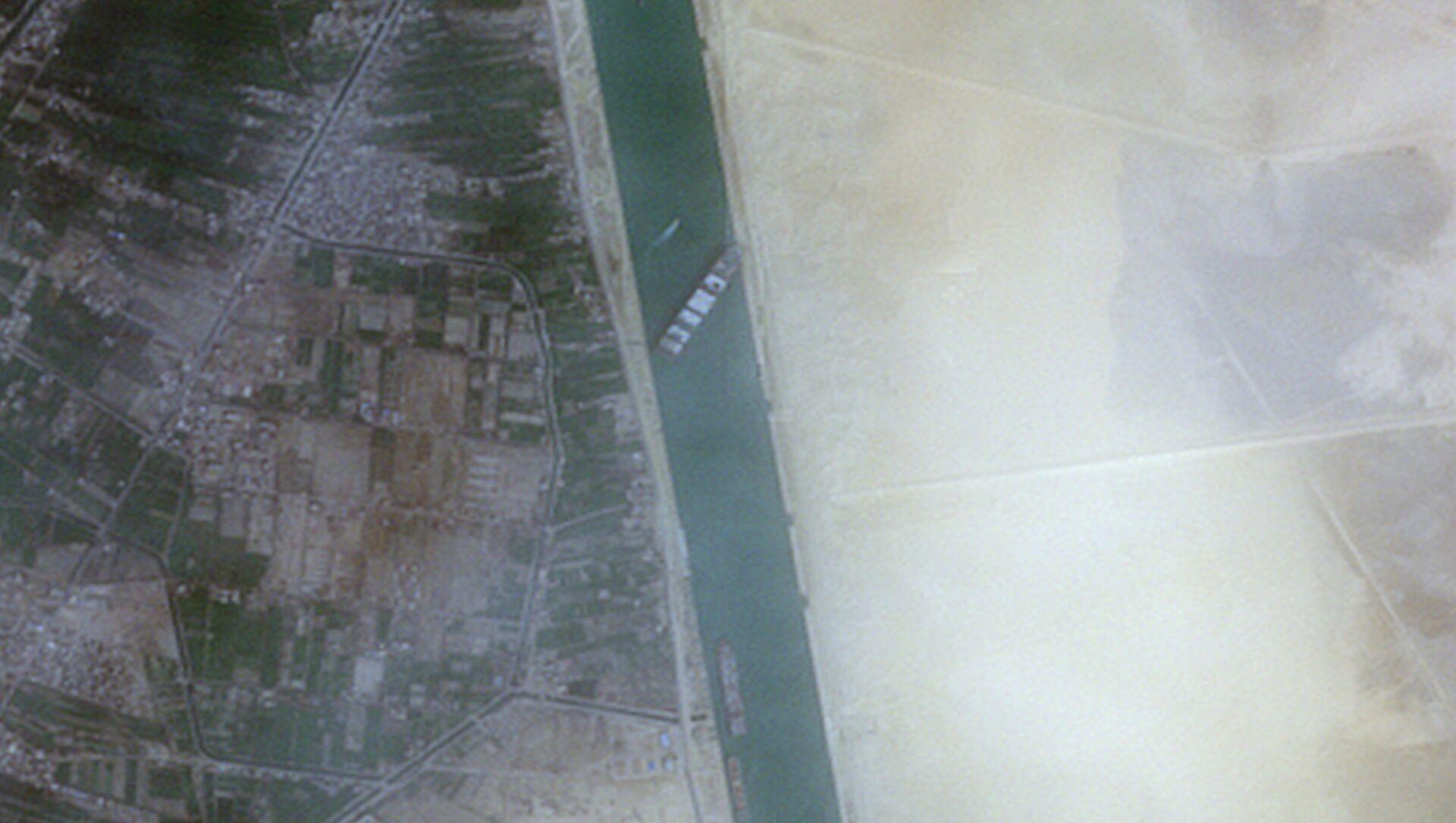 Kontejnerová loď Ever Given v Suezském průplavu - Sputnik Česká republika, 1920, 26.03.2021