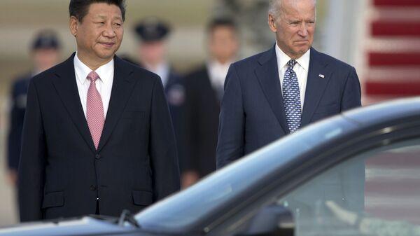Si Ťin-pching a Joe Biden  - Sputnik Česká republika