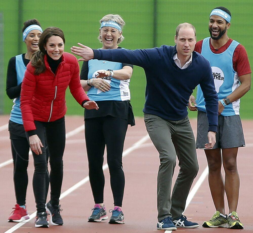 Vévodkyně z Cambridge Kate Middletonová a princ William se baví během soutěže v Londýně v roce 2017.