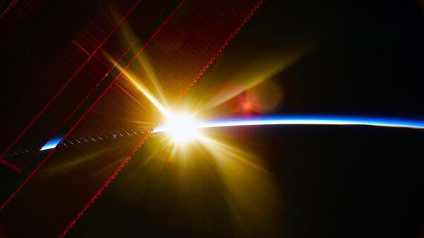 Pohled z ISS na úsvit nad Zemí - Sputnik Česká republika