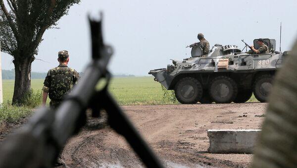 Ukrajinští vojáci v zóně konfliktu na východě Ukrajiny. Ilustrační foto - Sputnik Česká republika