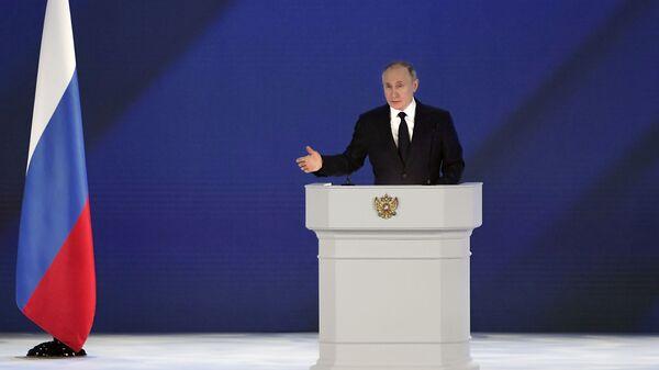 Президент РФ Владимир Путин во время выступления с ежегодным посланием Федеральному Собранию - Sputnik Česká republika