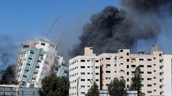 ВВС Израиля нанесли авиаудары по высотке в Газе, в которой расположены офисы американского информагентства Associated Press и катарского телеканала «Аль-Джазира» - Sputnik Česká republika