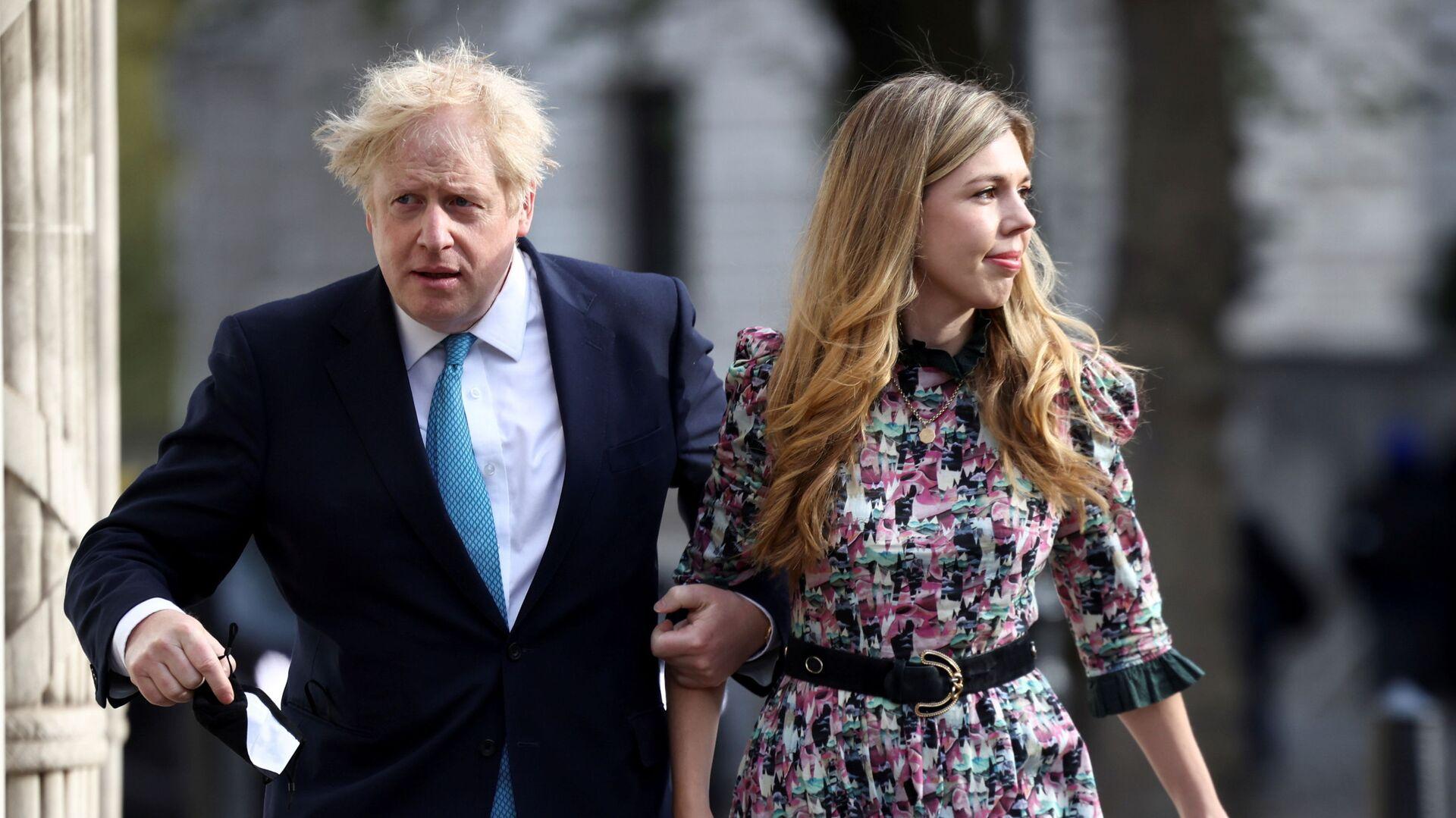 Britský premiér Boris Johnson s Kerry Symondsovou - Sputnik Česká republika, 1920, 30.05.2021