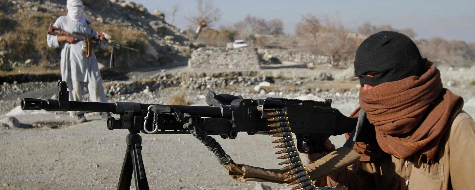 Bojovníci radikálního hnutí Tálibán v Afghánistánu - Sputnik Česká republika, 1920, 02.08.2021