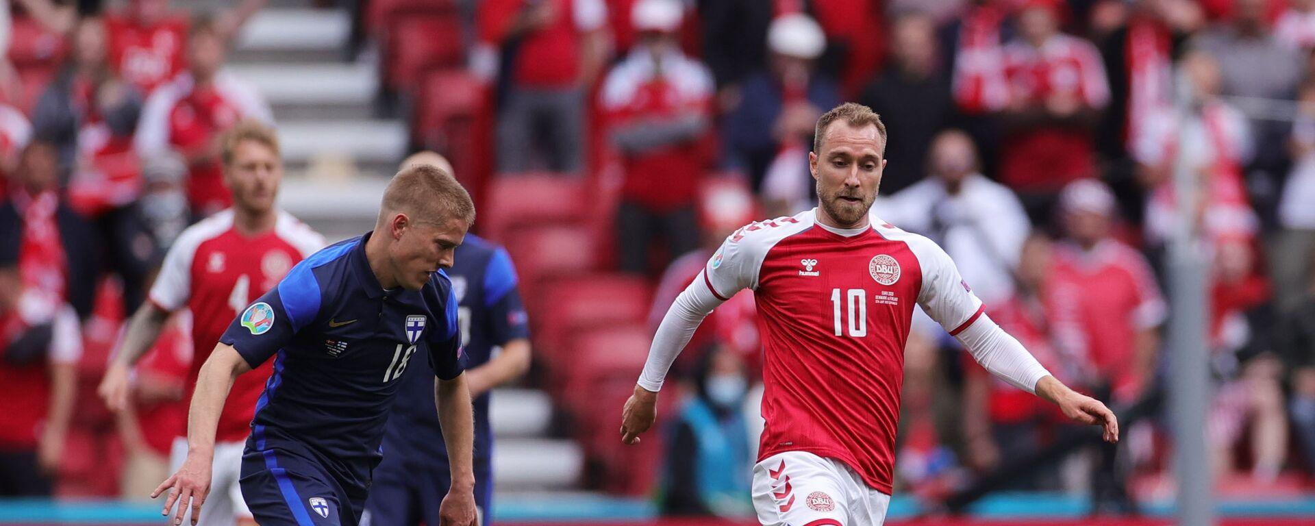 Christian Eriksen během fotbalového zápasu Dánska a Finska na EURO 2020 - Sputnik Česká republika, 1920, 13.06.2021