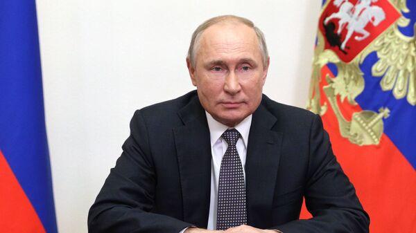 Президент России Владимир Путин во время видеообращения к участникам и гостям IX Московской конференции по международной безопасности - Sputnik Česká republika