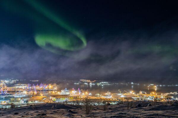 Fotografie Aurory v Murmansku od ruského fotografa Vitalije Novikova - Sputnik Česká republika