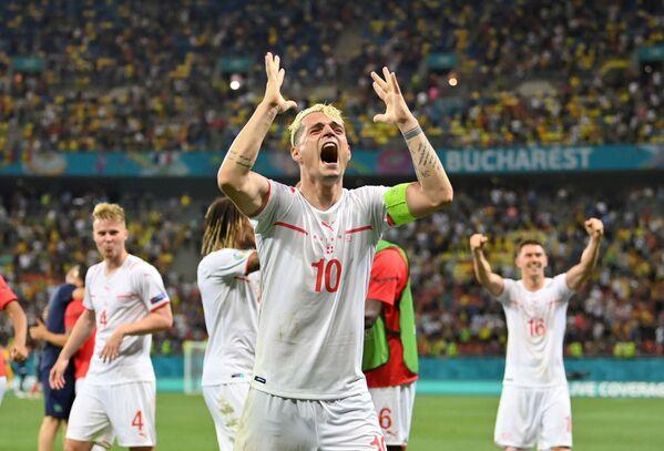 Švýcarský fotbalista Granit Xhaka se raduje z vítězství svého týmu - Sputnik Česká republika