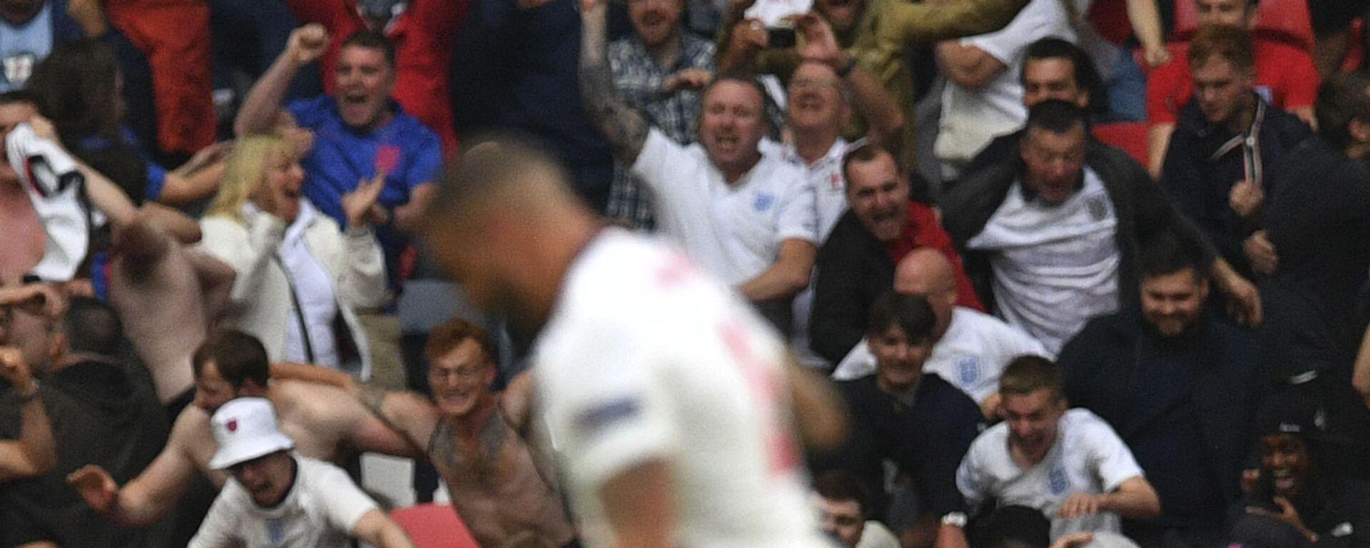 Hráč Anglie poté, co vstřelil gól proti Německu na EURO 2020 - Sputnik Česká republika, 1920, 05.08.2021