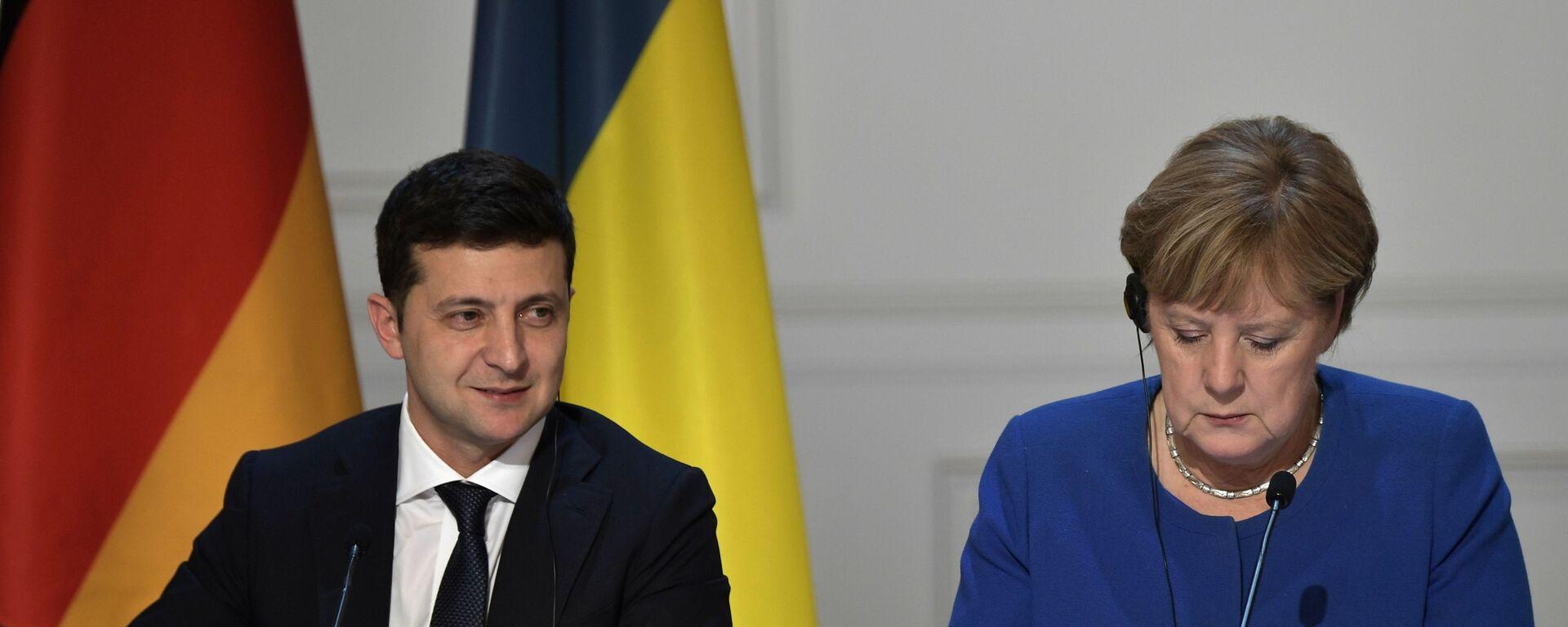 Ukrajinský prezident Volodymyr Zelenskyj a německá kancléřka Angela Merkelová - Sputnik Česká republika, 1920, 12.07.2021