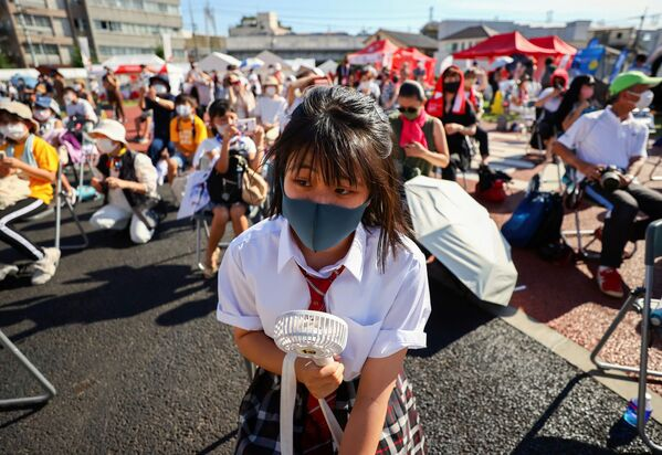 Люди на мероприятии torch kiss в Токио  - Sputnik Česká republika