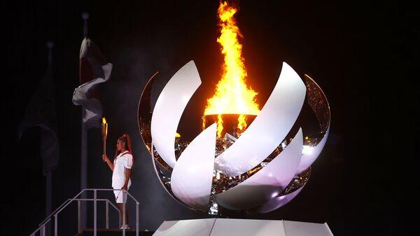 Zapálení olympijského kotle na zahajovacím ceremoniálu - Sputnik Česká republika