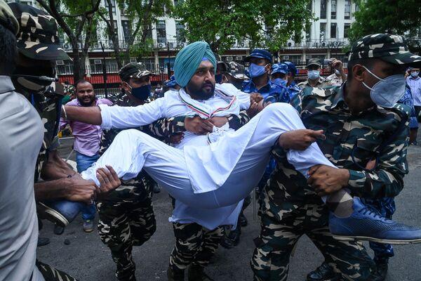 Protesty proti vládní Indické lidové straně ve městě Nové Dillí. - Sputnik Česká republika