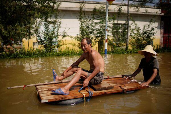 Zaplavená vesnice v provincii Che-nan. - Sputnik Česká republika