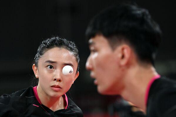 Korejci Lee Sang-su a Jeon Ji-hee s Lin Yun-ju a Cheng I-Chingem z jižního Tchaj-wanu během olympijských her - Sputnik Česká republika