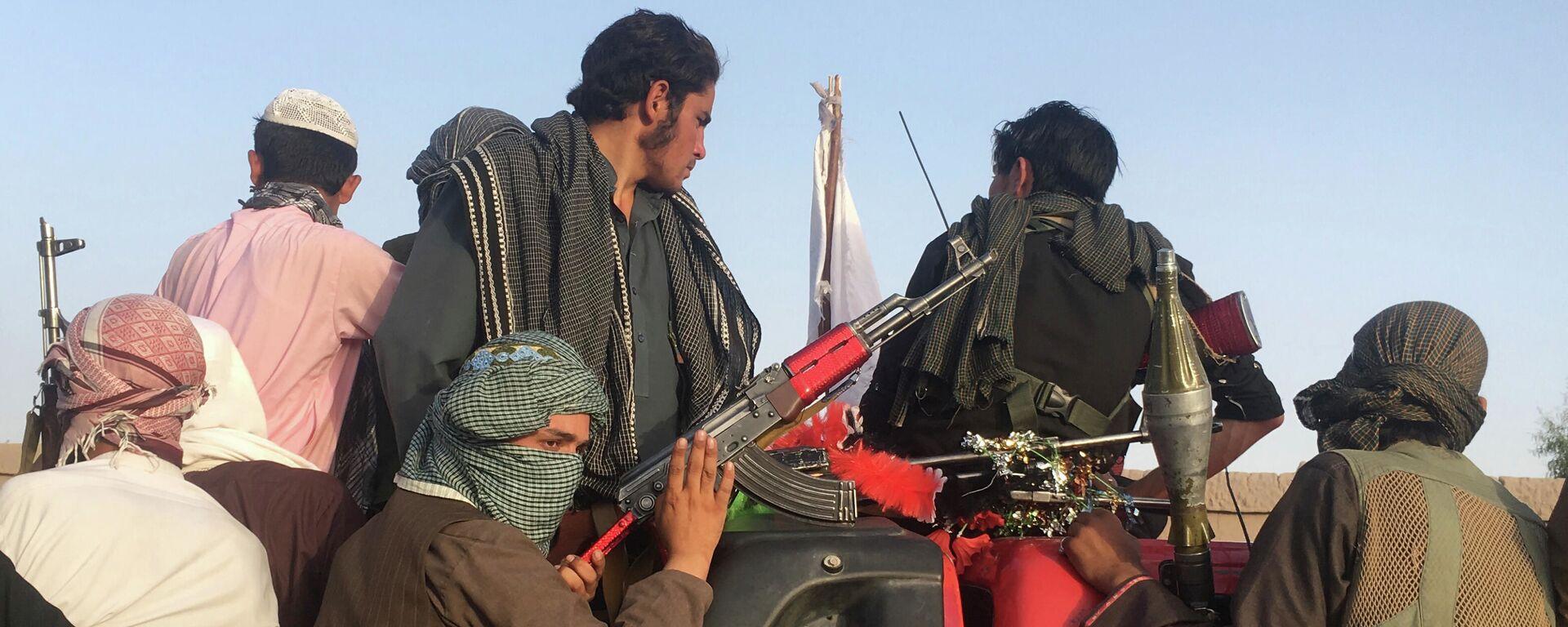 Bojovníci radikálního hnutí Tálibán* v Afghánistánu - Sputnik Česká republika, 1920, 09.08.2021