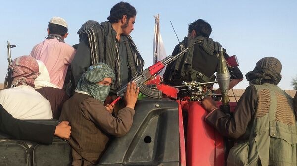 Боевики радикального движения Талибан* в Афганистане - Sputnik Česká republika