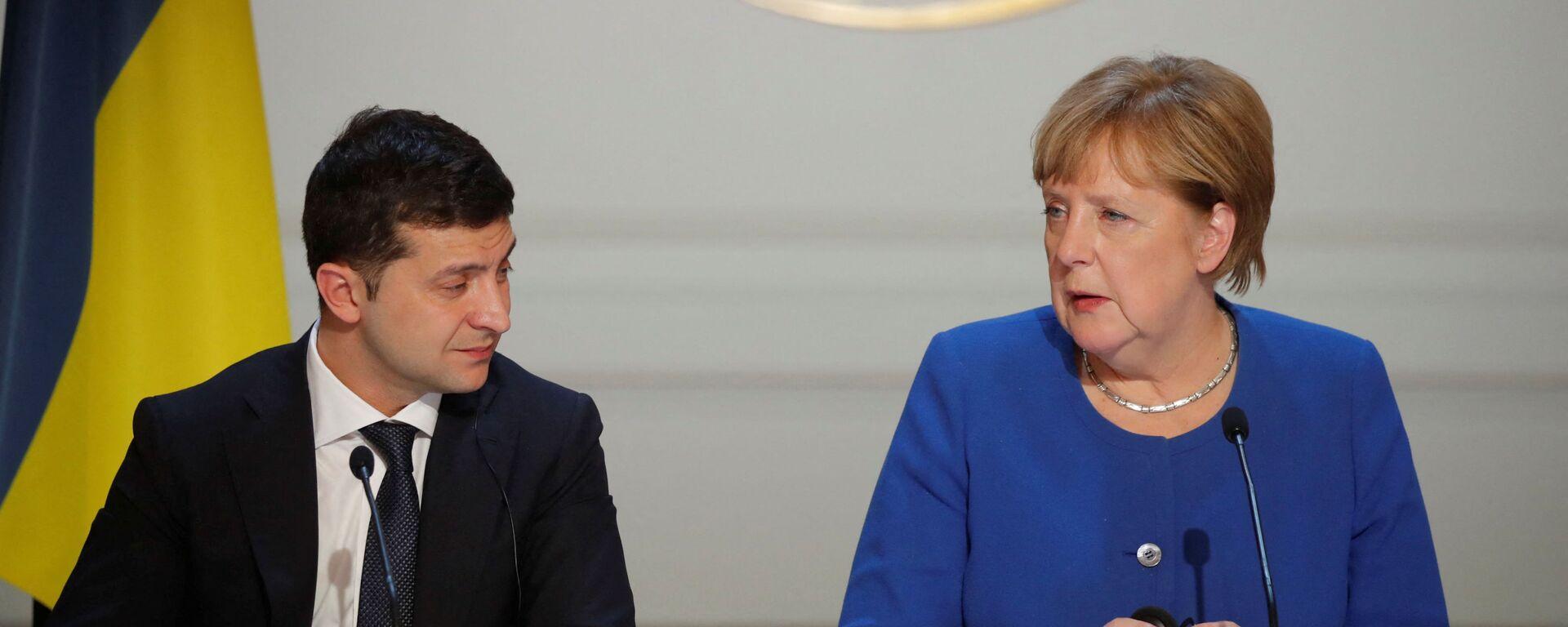Prezident Ukrajiny Volodymyr Zelenskyj a kancléřka Německa Angela Merkelová na tiskové konferenci - Sputnik Česká republika, 1920, 14.08.2021