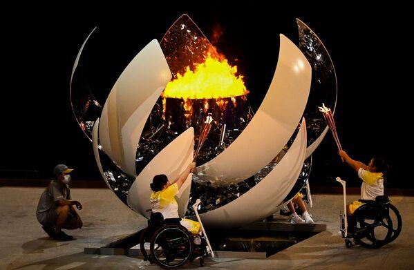 Zapálení paralympijského ohně při slavnostním zahájení XVI. letních paralympijských her - Sputnik Česká republika