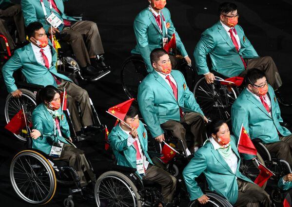 Sportovci čínského týmu vystupují během zahajovacího ceremoniálu XVI. letních paralympijských her - Sputnik Česká republika