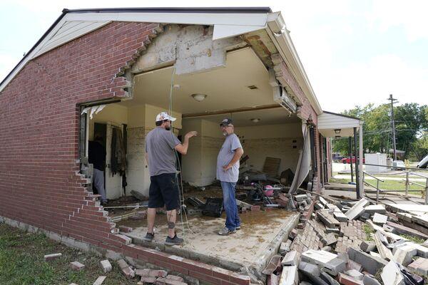 Poničený dům v důsledku povodní. Stát Tennessee, USA. - Sputnik Česká republika