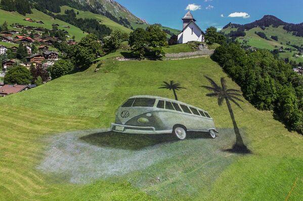 Obří malba od francouzského umělce Guillaumeho Legrose ve švýcarských Alpách - Sputnik Česká republika