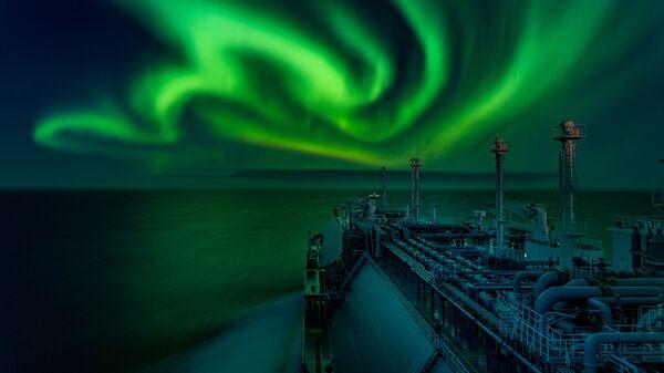Снимок Polar Lights Dance российского фотографа Dmitrii Rybalka, ставший победителем в категории Aurorae конкурса Royal Observatory's Astronomy Photographer of the Year 13 - Sputnik Česká republika