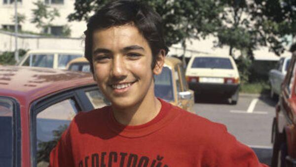 Chlapec v tričku s nápisem Perestrojka SSSR. Ilustrační foto - Sputnik Česká republika