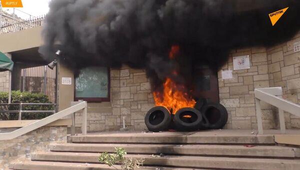 Protivládní protesty a požár velvyslanectví USA v Hondurasu  - Sputnik Česká republika