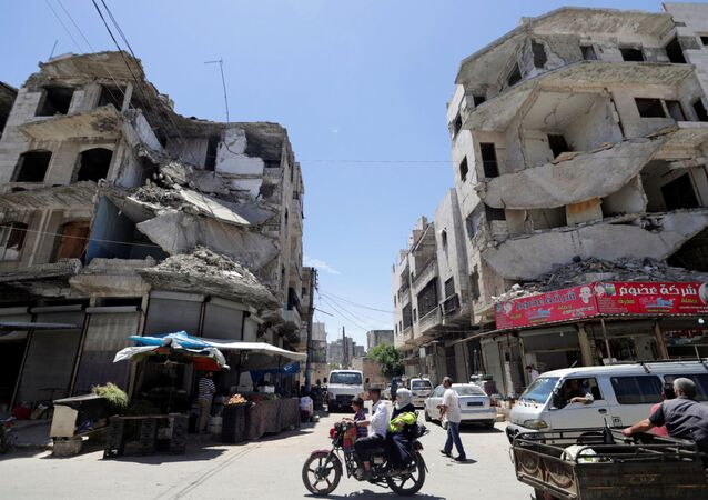 Zničené domy v Idlibu, Sýrie