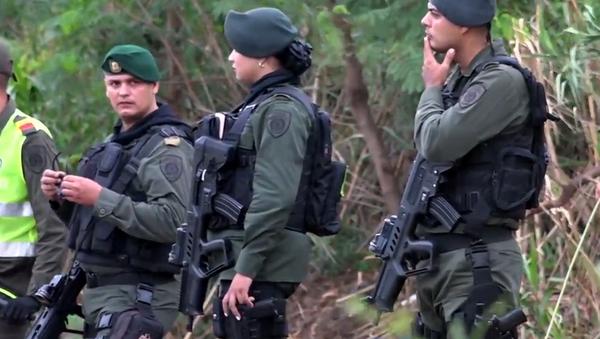 Hranice jsou otevřeny. Policejní jednotky z Kolumbie hlídají hranice s Venezuelou kvůli vlně migrantů (VIDEO) - Sputnik Česká republika
