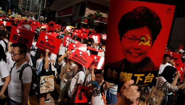 Demonstrace v Hongkongu proti návrhu extradičního zákona (dne 9. června 2019) - Sputnik Česká republika