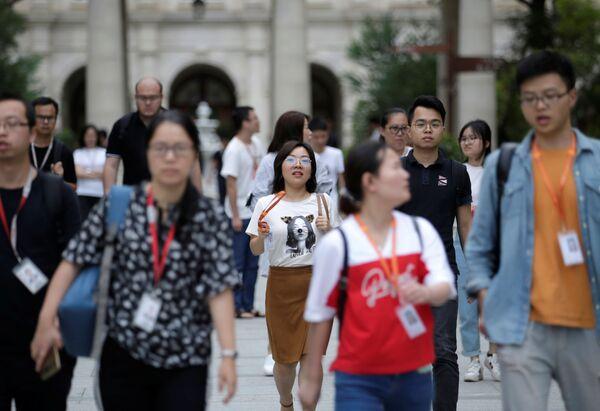 Zaměstnanci společnosti Huawei jdou domů. - Sputnik Česká republika